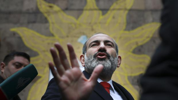 Acting Armenian Prime Minister Nikol Pashinian leaves a polling station during an early parliamentary election in Yerevan, Armenia, on Sunday (Vahan Stepanyan/PAN Photo via AP)