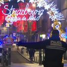 Emergency services arrive on the scene of a Christmas market in Strasbourg (AP)