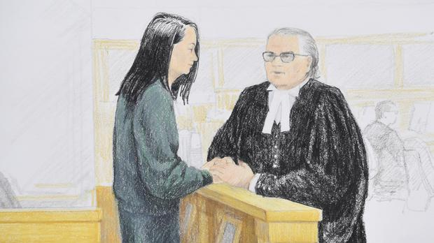 Meng Wanzhou, chief financial officer of Huawei Technologies, speaks to her lawyer during a bail hearing (Jane Wolsak/The Canadian Press via AP)