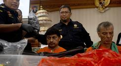 Two suspected drug smugglers in Indonesia (AP Photo/Firdia Lisnawati)