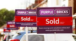 The Online estate agency trimmed its full-year revenue guidance.