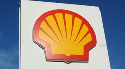 File photo dated 03/02/11 of a Royal Dutch Shell logo. The oil giant is being sued by the Nigerian government.