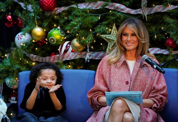 Story time: Melania Trump receives applause from Tearrianna Cooke-Starkey during the traditional first lady's visit to the Children's National Hospital in Washington. REUTERS/Kevin Lamarque