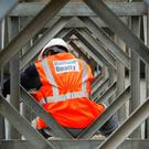 Balfour Beatty said it will beat its annual expectations due to an additional sale of one of its assets (Newscast/PA)