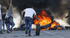 Palestinian protesters in the West Bank (Majdi Mohammed/AP)