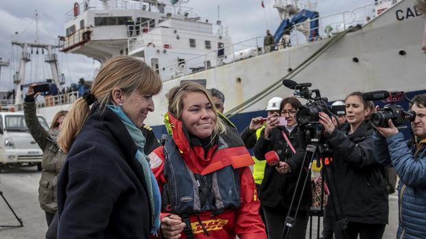 British solo sailor Susie Goodall is received by her mother after arriving on the cargo ship MV Tian Fu in Punta Arenas, Chile (Joel Estay/AP)