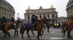 Mounted police officers take position during a protest at the Paris Opera House (Michel Euler/AP)