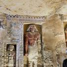 An excavation worker stands at the recently uncovered tomb (Amr Nabil/AP)
