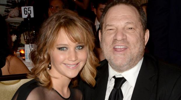 NO RELATIONSHIP: Jennifer Lawrence with Harvey Weinstein