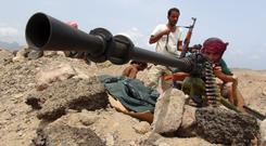 THE OUTBREAK OF PEACE: Frontline fighters in the war in Yemen. Photo: Reuters