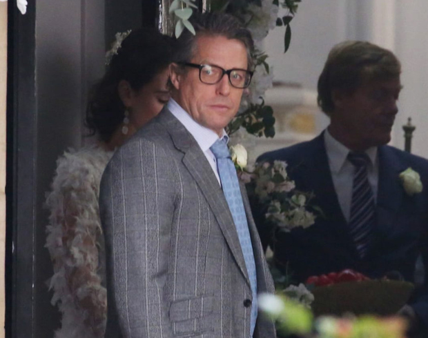 TOGETHER AGAIN: Hugh Grant, Rowan Atkinson and Andie MacDowell in London as they filmed the Comic Relief follow-up to 'Four Weddings And A Funeral'
