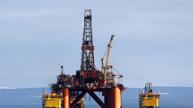 The Oil platform Stena Spey is moved with tug boats amongst other rigs which have been left in the Cromarty Firth near Invergordon in the Highlands of Scotland. Rig platforms are being stacked up in the Cromarty Firth as oil prices continue to decline having a major impact on the UK's North Sea oil industry leaving thousands of people out of work.