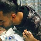 Ali Hassan with his two-year-old son Abdullah in a Sacramento hospital (Council on American-Islamic Relations/AP)