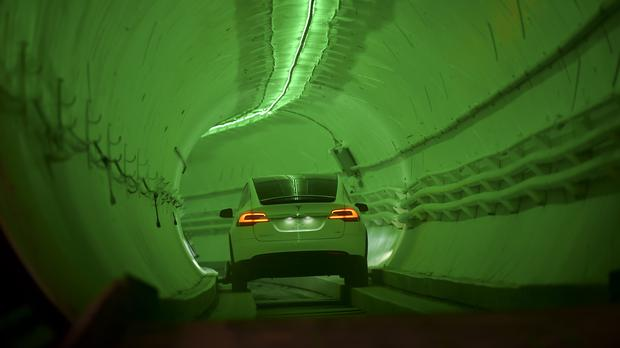 A modified Tesla Model X drives in the tunnel entrance before the unveiling event for the Boring Co Hawthorne test tunnel (Robyn Beck/Pool Photo via AP)