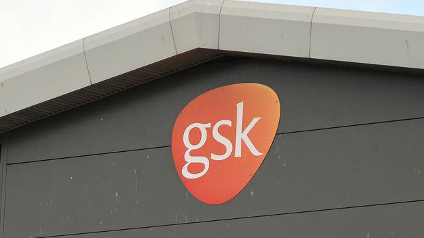 The FTSE 100 closed 0.96% higher, led by pharmaceutical giant GlaxoSmithKline (Andy Buchanan/PA)