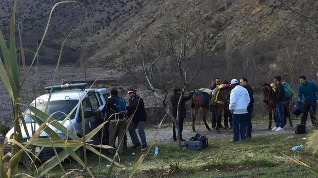 A security team near where the bodies of two tourists were found near Imlil in the Atlas Mountains(2M via AP)