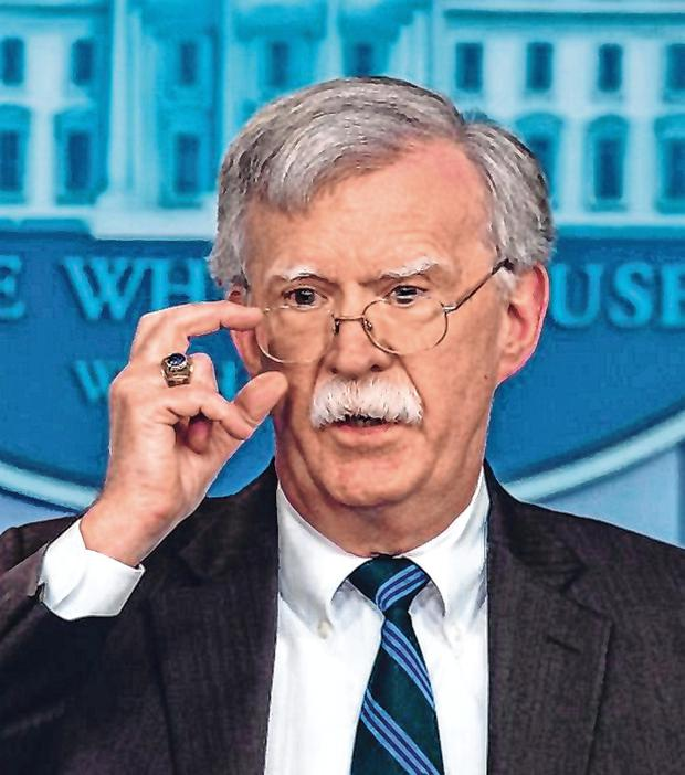 Wake up call: US national security adviser John Bolton has sounded warnings about Chinain
