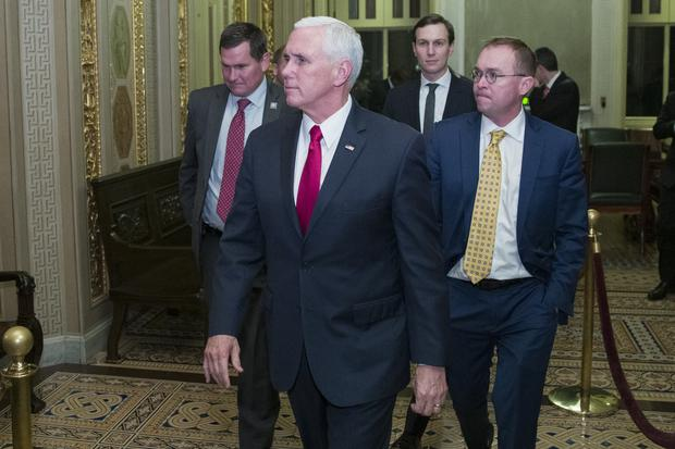 Vice President Mike Pence with Jared Kushner and Mick Mulvaney as they depart for the night without a bill that would pay for President Donald Trump's border wall a (Alex Brandon/AP)