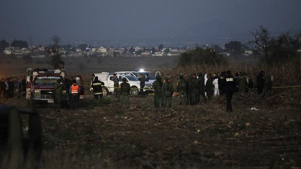 Emergency rescue personnel arrive to the scene of the helicopter crash (Pablo Spencer/AP)