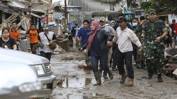 In Video: Hundreds flee amid fears of second tsunami ...