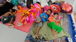 Safe: Young tsunami survivors rest in a mosque in Tenjolahang, Banten. Photo: Sonny Tumbelaka/AFP/GETTY IMAGES