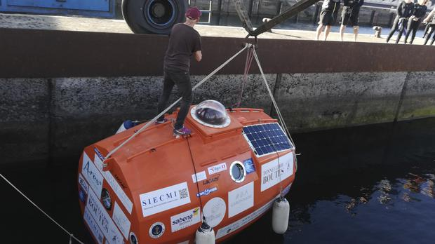 Frenchman Jean-Jacques with his capsule (Jean-Jacques Savin/AP)
