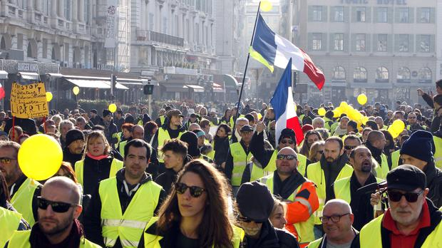 Demonstrators wearing their yellow vests take part in a march in Marseille (AP)