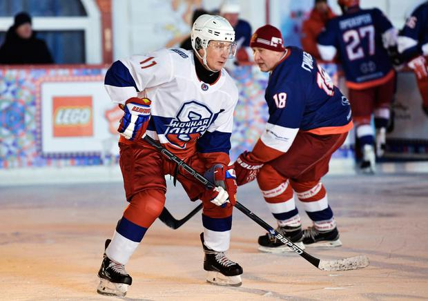 Breaking the ice: Left, Russian President Vladimir Putin, who is offering a new summit with US President Donald Trump, takes part in an ice hockey match in Red Square, Moscow, at the weekend. Photo: AFP/Getty Images