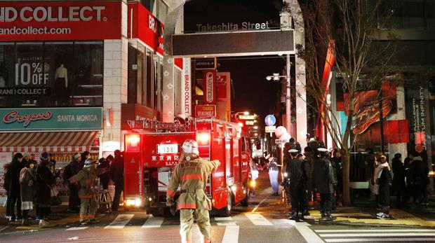 Police and firefighters at the scene of a car 'attack' near Takeshita Street in Tokyo (Yuta Omori/Kyodo News/AP)