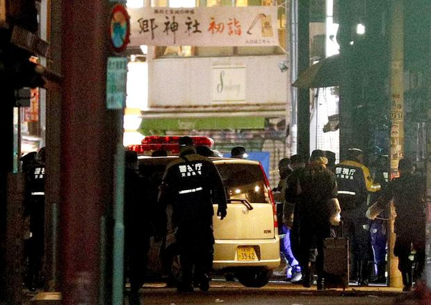 A car slammed into pedestrians early Tuesday on a street where people had gathered for New Year's festivities in downtown Tokyo.(Yuta Omori/Kyodo News via AP)