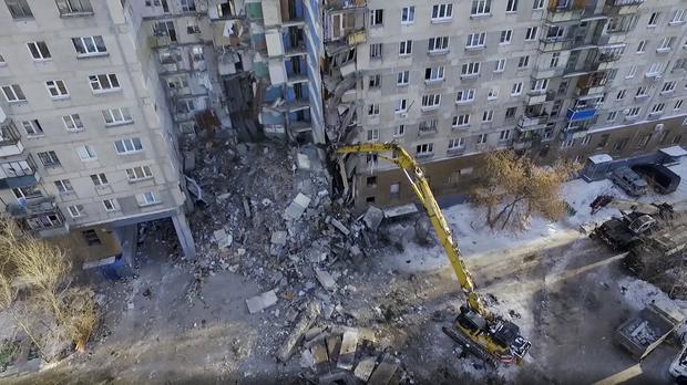 Work at the scene of a collapsed section of the apartment building (Russian Ministry for Emergency Situations/AP)