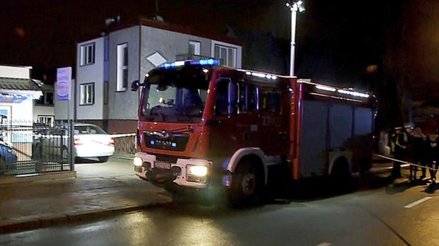 A fire engine stands outside an Escape Room game location in Koszalin (TVN News/AP)