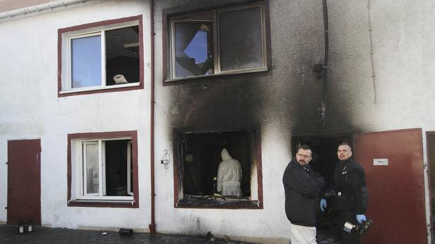 Forensic experts examine the site of a fire in an Escape Room, in Koszalin (AP Photo)