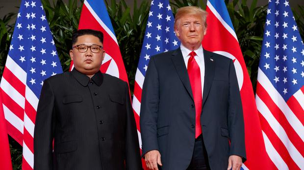 President Donald Trump, right, and North Korean leader Kim Jong Un (Evan Vucci/AP)