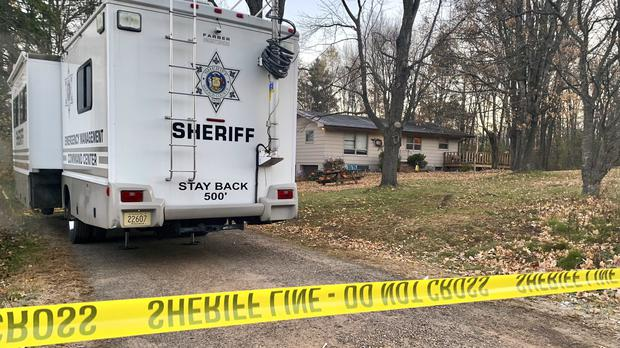 Police at the Closs home (AP Photo/Jeff Baenen, File)