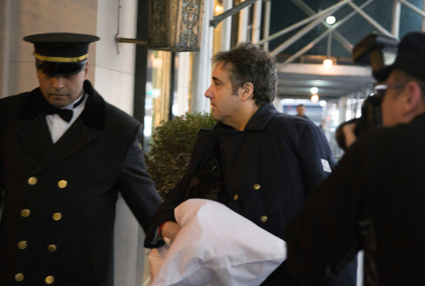 Evidence: Michael Cohen arrives at his home in New York following surgery on his shoulder. Photo: AP