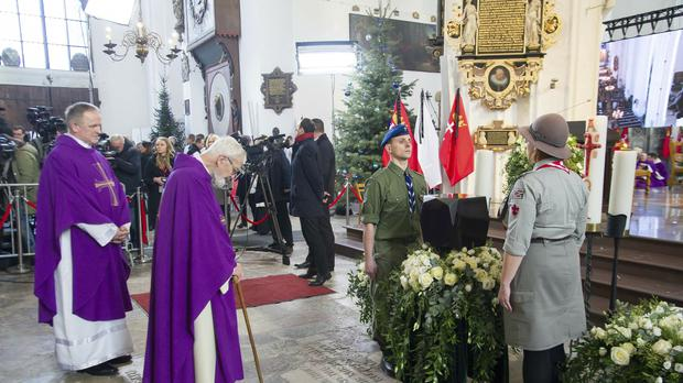 Catholic priests bowing with respect before the urn with ashes of Gdansk mayor Pawel Adamowicz (AP Photo/Wojtek Strozyk)