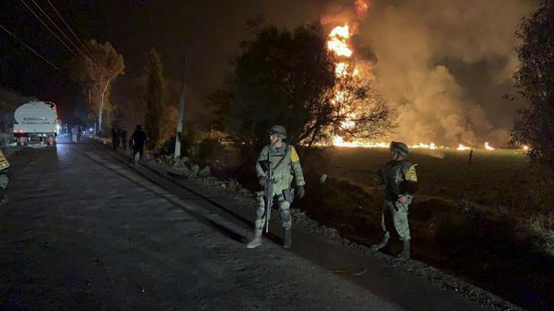Soldiers near an oil pipeline explosion in Tlahuelilpan, Hidalgo state, Mexico (Secretary of National Defense via AP)