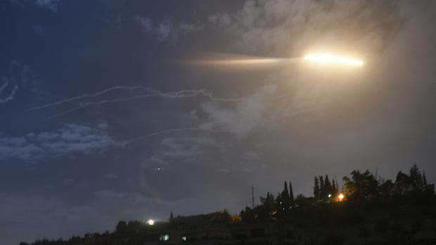 Missiles flying into the sky near international airport, in Damascus (SANA/AP)