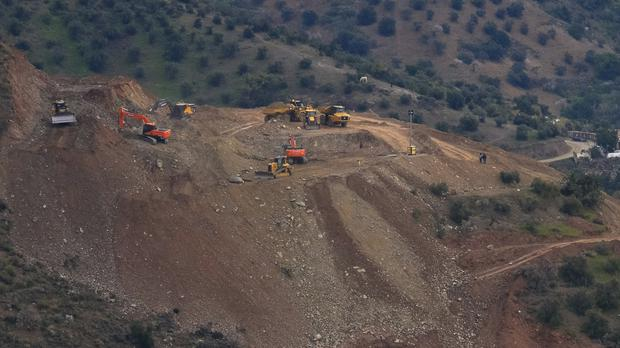 Drill machines and excavating machinery work on top of a mountain next to a deep borehole to reach a two-year-old boy trapped near the town of Totalan in Malaga (Gregorio Marrero/AP)