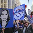 Demonstrators hold posters of Kamala Harris 2020 during the Women's March in Los Angeles (Damian Doverganes/AP)