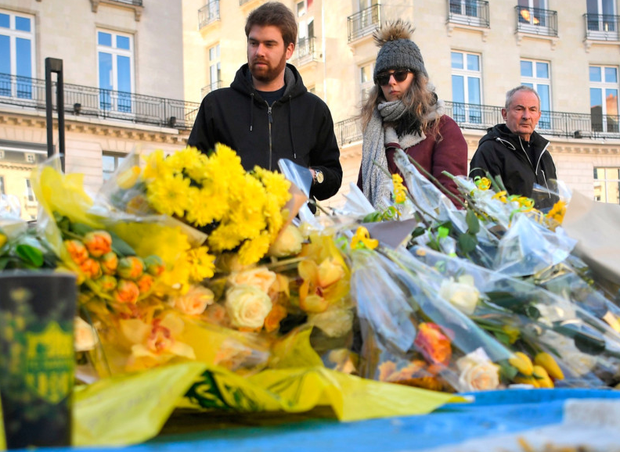 Shock: People in Nantes at a tribute to missing Emiliano Sala. Photo: Getty Images