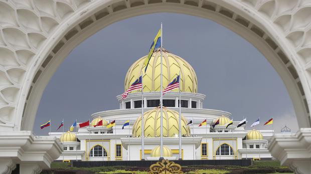 Flags fly at the Malaysia National Palace in Kuala Lumpur (Vincent Thian/AP)