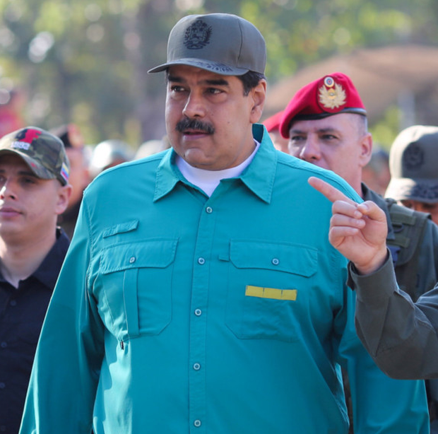 Tensions: Nicolas Maduro watches a military exercise yesterday