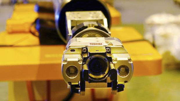 A remote-controlled melted fuel probe device is unveiled by Toshiba (Mari Yamaguchi/AP)