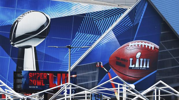 A Super Bowl 53 wrap is installed on the outside of Mercedes-Benz Stadium in Atlanta (Curtis Compton/AP)