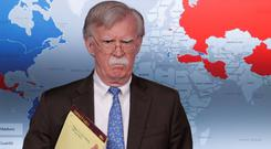 Plan of attack?: US National Security Adviser John Bolton holds the folder with '5,000 troops to Colombia' written across it. Photo: REUTERS
