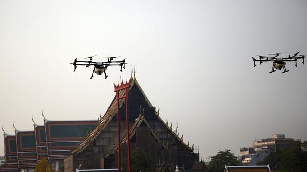 Bangkok using water-spraying drones and planes to try to cut air
