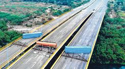 'Red line': An aerial view of the Tienditas Bridge, on the border between Cucuta, Colombia, and Tachira, Venezuela, after Venezuelan military forces blocked it with containers yesterday. Photo: Getty
