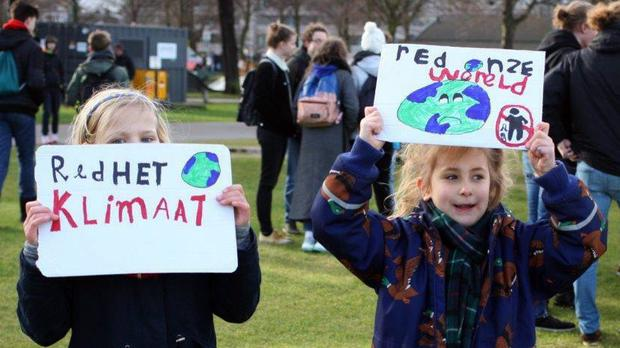 Two girls during a march in support of more ambitious climate policies in The Hague (Michael Corder/AP)